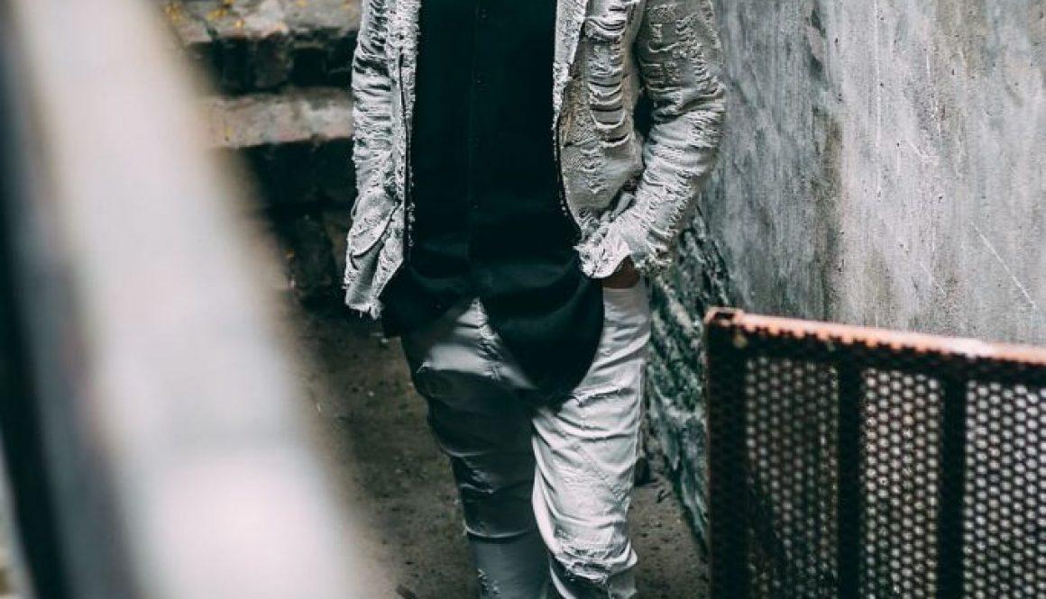 man-wearing-distressed-gray-blazer-black-shirt-and-gray-pants